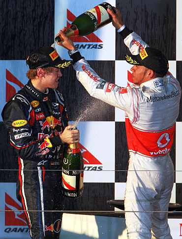 Sebastian Vettel celebrates with Lewis Hamilton after winning the World Cup