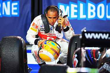 Lewis Hamilton checks his car after the race