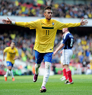 Neymar celebrates scoring his opening goal against Scotland