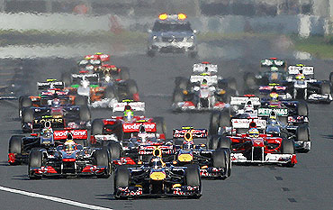 Red Bull Formula One driver Sebastian Vettel of Germany leads the pack at the start of the Australian F1 Grand Prix