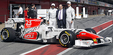 HRT Formula One drivers Narain Karthikeyan of India (left) and Vitantonio Liuzzi of Italy (right) pose with Hispania Racing HRT team chairman Jose Ramon Carabante