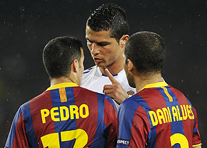 Real Madrid's Cristiano Ronaldo (centre) argues with Bracelona's Pedro Rodriguez (left) and Dani Alves