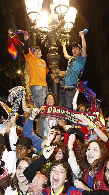 Barcelona's supporters celebrate in the city centre after their team qualified for the Champions League final by beating Real Madrid