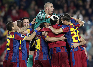 Barcelona players celebrate after qualifying for the Champions League final
