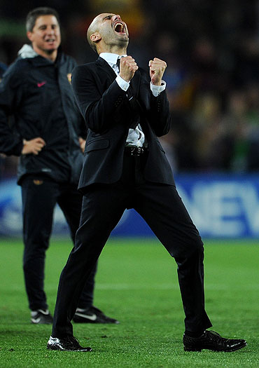 Barcelona's coach Pep Guardiola celebrates after qualifying for the Champions League final
