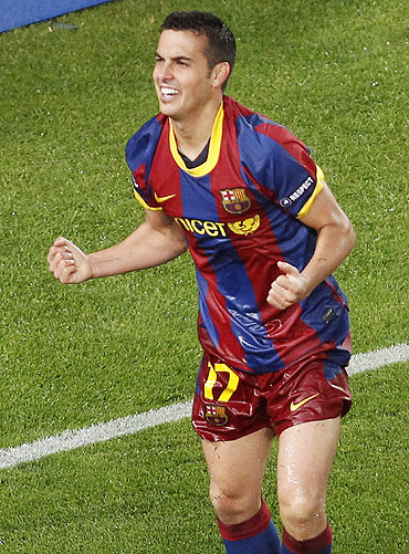 Barcelona's Pedro Rodriguez celebrates after scoring against Real Madrid