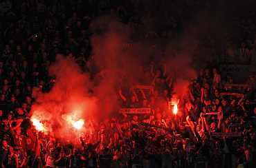 Schalke 04 fans light flares during their Champions League semi-final second leg soccer match against Manchester United