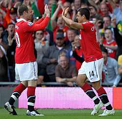 Javier Hernandes celebrates with Rooney