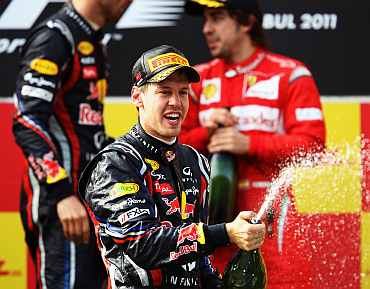 Sebastian Vettel celebrates after winning