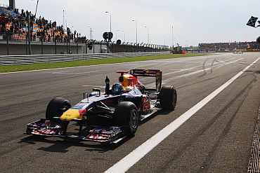Sebastian Vettel celebrates after crossing the finish line of the Turkish Grand Prix