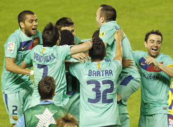 Barcelona's players celebrate after winning the Spanish first division league at the Ciudad de Valencia Stadium in Valencia