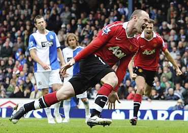 Wayne Rooney celebrates after scoring against Blackburn