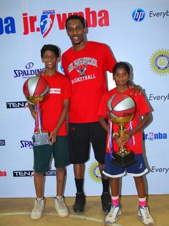 BA star Brandon Jennings, flanked by the winners of the Jr. NBA/WNBA National Skills Challenge, Danish Qureshi of Mumbai (left) and Nishanti of Chennai