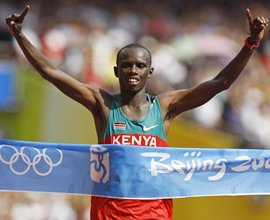 Samuel Wanjiru crosses the finish line first at the Beijing Olympics