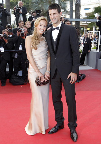 Serbian tennis player Novak Djokovic and his girlfriend Jelena Ristic arrive on the red carpet at the 64th Cannes Film Festival