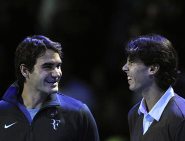 Roger Federer (left) with Novak Djokovic