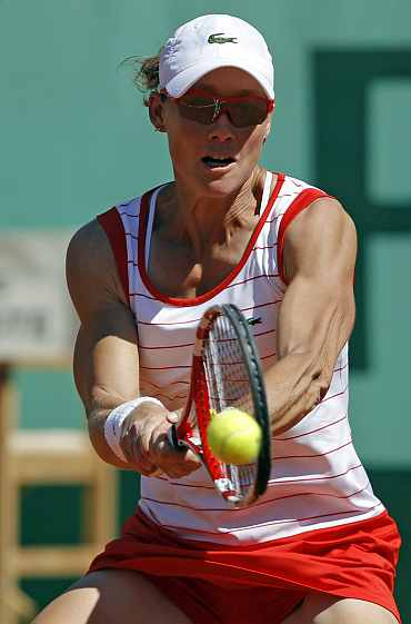 Samantha Stosur returns during her French Open match against Iveta Benesova
