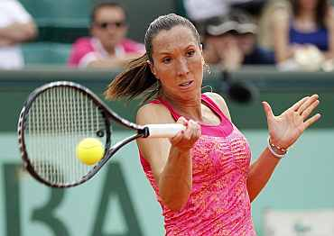 Jelena Jankovic returns during her French Open match against Alona Bondarenko
