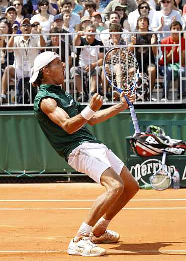Ruben Ramirez Hidalgo reacts after winning his French Open match against Marin Cilic