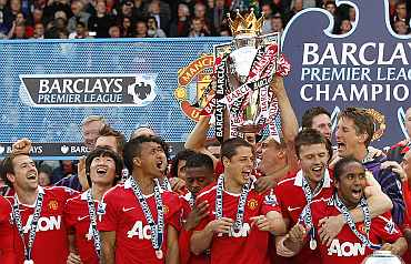 Manchester United players celebrate after winning the Premier League title