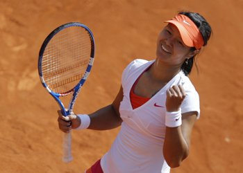 Li Na of China celebrates after winning her match against Barbora Zahlavova Strycova