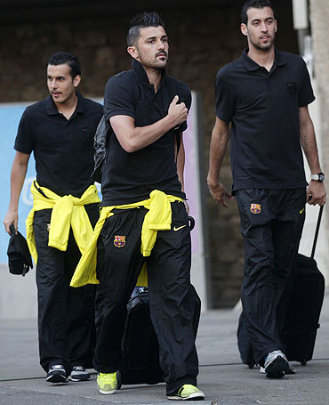 Barcelona's Pedro Rodriguez (left to right), David Villa and Sergio Busquets