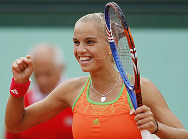 Aranxta Rus celebrates after defeating Kim Clijsters