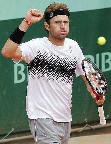Mardy Fish of the US reacts after winning his match against Robin Haase of the Netherlands