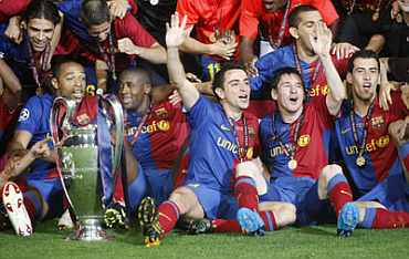 Barcelona players celebrate after winning their Champions League against Manchester United in 2009