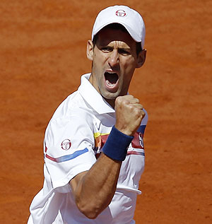Novak Djokovic of Serbia reacts during his match against Juan Martin Del Potro of Argentina