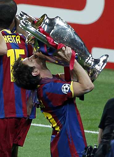 Lionel Messi kisses the trophy after winning the Champions League final against Manchester United