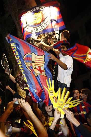 Barcelona fans celebrate after their team beat Manchester United to win Champions League