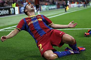Barcelona's David Villa reacts after scoring a goal against Manchester United