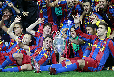 Barcelona players celebrate after winning the Champio
