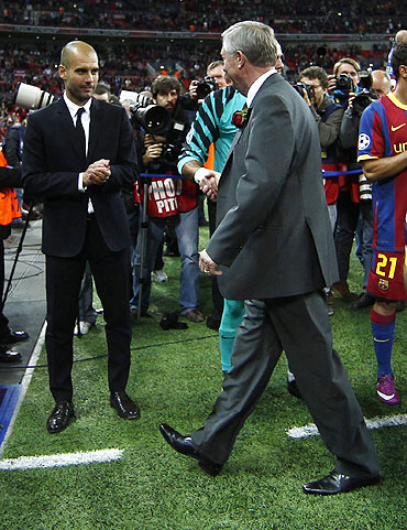 Manchester United's manager Alex Ferguson (centre) congratulates Barcelona's goalkeeper Victor Valdes and manager Pep Guardiola (left) after their Champions League final
