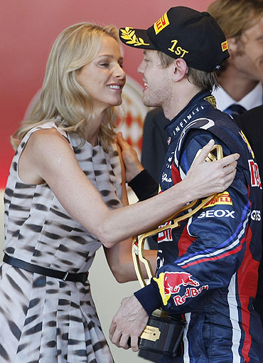 Red Bull Formula One driver Sebastian Vettel of Germany (right) is congratulated by Charlene Wittstock, the fiancee of Prince Albert II of Monaco, after he