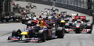 Red Bull's Sebastian Vettel leads the race at the start of the Monaco F1 Grand Prix