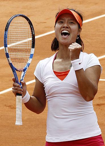 Li Na reacts after winning her match against Petra Kvitova