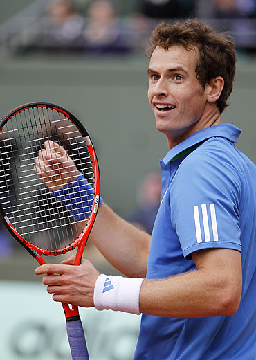 Andy Murray reacts after winning his match against Viktor Troicki