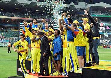 The Chennai Super Kings celebrate with the trophy after winning the 2010 Champions League Twenty20 final
