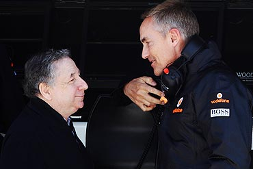 FIA President Jean Todt (left) talks with McLaren Team Principal Martin Whitmarsh
