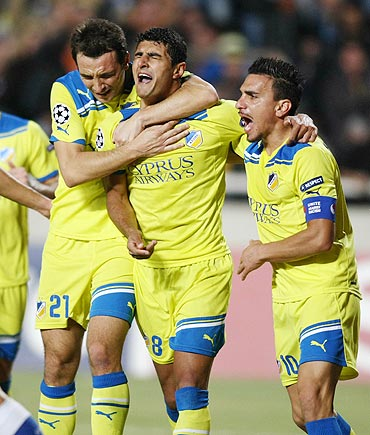 APOEL Nicosia's Gustavo Manduca (left), Ailton Almeida and Costas Charalambides (right) celebrate