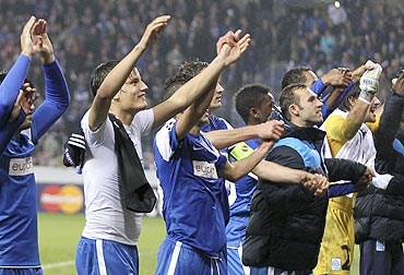 KRC Genk's players celebrate after the Champions League match against Chelsea