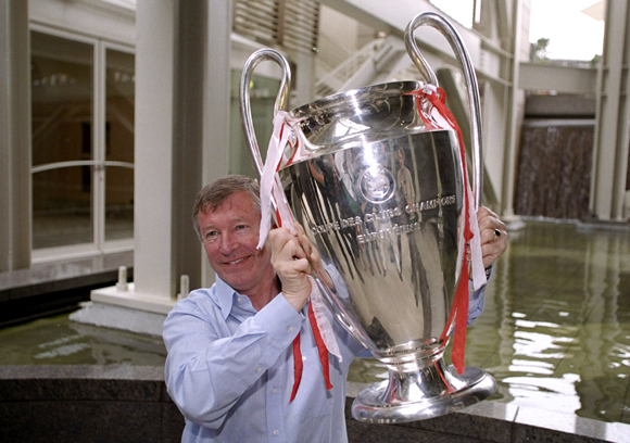 Sir Alex Ferguson with the 1999 UEFA Champions League trophy