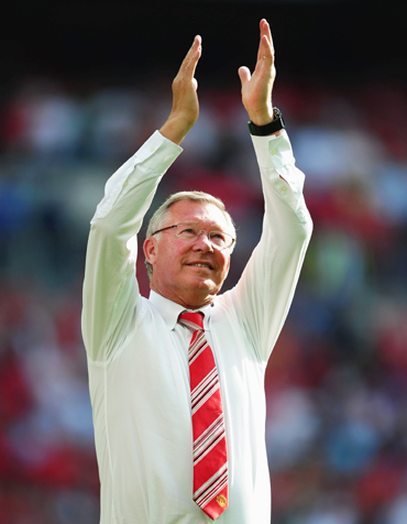 -Manchester United manager Sir Alex Ferguson applauds the fans after victory in the FA Community Shield match between Chelsea and Manchester United at Wembley Stadium