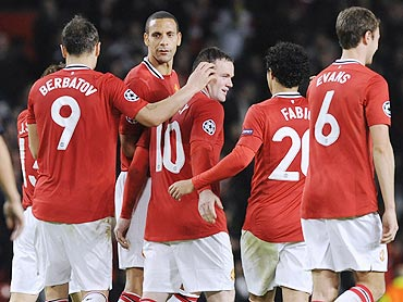 Manchester United's Wayne Rooney (centre) celebrates with teammates after scoring against Otelul Galat