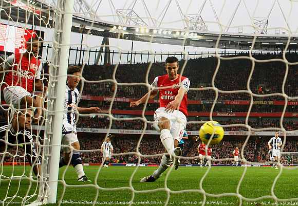 Robin van Persie scores for Arsenal during his match against Blackburn Rovers