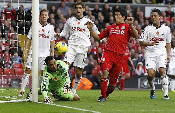 Liverpool's Luis Suarez tries to score against Swansea
