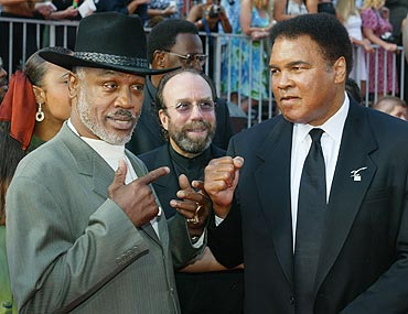 Joe Frazier (left) and Muhammad Ali