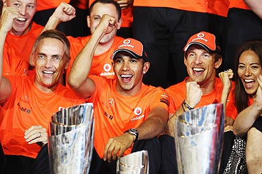 Lewis Hamilton (2nd left) of McLaren celebrates with his Team Principal Martin Whitmarsh (left), Jenson Button (2nd right) and Button's girlfriend Jessica Michibata (right)